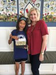 An-Mei donates money to RMHCA