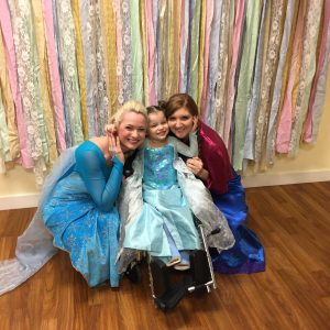 LJ takes a picture with Queen Elsa and Princess Anna