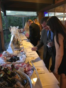 Looking at the silent auction items at Gala for Giving