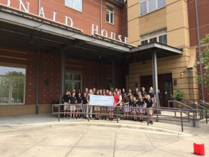 Prince of Peace students pose with their check outside of RMHCA