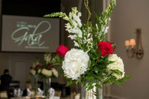 Heart of the House Gala centerpieces with mixed flowers