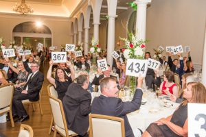 Picture of gala guests bidding during the live auction.