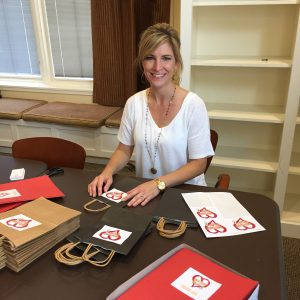Jeannie helps RMHCA prepare for the 2018 Red Shoe Run.