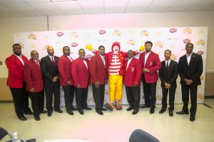 Owner/operator Dale Thornton Jr. (left of Ronald) and the Alpha Kappa Psi Fraternity. Source: Ven Sherrod