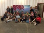 RMHCA and Hand in Paw staff gather around the finished artwork.