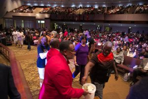 Attendees donate money to RMHCA. This love offering is taken up in each city of the gospel tour. Photo: Ven Sherrod
