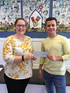L-R: RMHCA Communications Coordinator Brianne Denley accepts a check from Alpha Tau Omega Signature Events Chairman Charles Hernly. Source: RMHCA