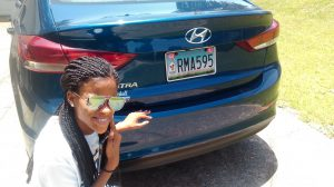 A former guest family shows off their RMHCA specialty car tag. Source: Victor Clements