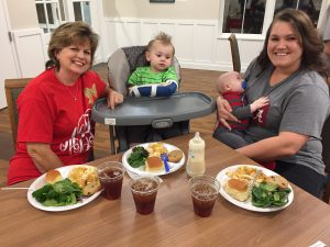 Mary, Brantley, John and Michelle enjoy dinner provided by meal volunteers. (Source: RMHCA)