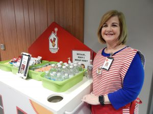 Volunteer Lisa Bolton shows off the Happy Wheels Cart.