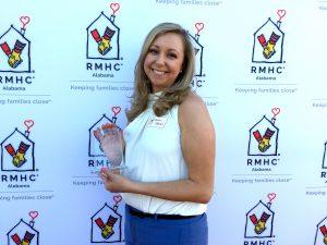 Aaron Fobian poses with her volunteer award.