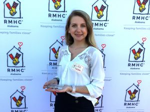 Lillie from Helena UMC poses with their volunteer award.