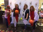 Four bowlers pose for a fun picture
