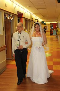 Dr. Carlo walks Rubia down the aisle. Source: University of Alabama at Birmingham