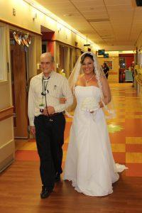 Dr. Carlo walks Rubia down the aisle. Source: University of Alabama at Birmingham