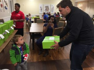 Santi and dad receive their Cheeriodicals box.