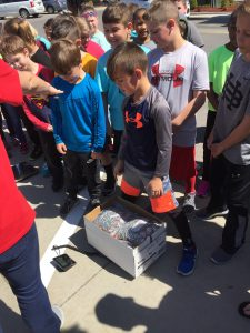 Students look on as their pop tabs are weighed for Pop Tab Pandemonium.