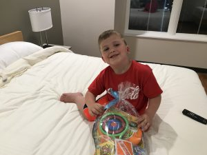 Trenton relaxes in the family's guest room at the Ronald McDonald House.