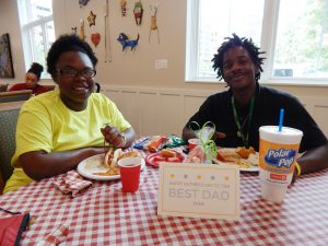 L-R: Commish and Demarius enjoy dinner together after visiting D'Niah.