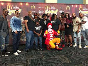 The White family poses with the tour artists and Ronald McDonald.