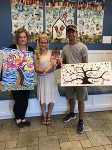 Ashton, HagenKate and Cody Bond show off the paintings created by a CCHS student.