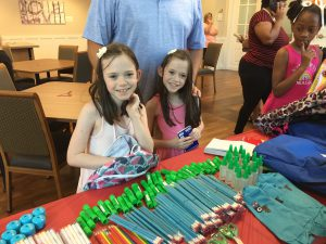 Emmalynn and Katelynn check out the school supplies donated by a local church.