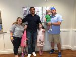 The Horne family with former Tide player Eryk Anders.