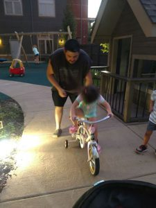 Nich teaches Addalynn to ride a bicycle. Source: Family photo