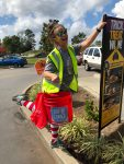 Supporter Debbie collects change in McCalla on Day of Change.
