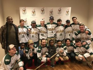 Cleo and Geo get to meet the UAB Hockey team at the Ronald McDonald House.