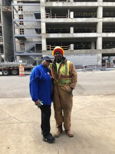 Felecia and Cleo pose in front of his work site, which is across the street from the Ronald McDonald House.