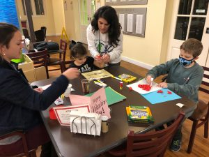 Leigh Anne Terch hosts Art Cart for two children and some parents.