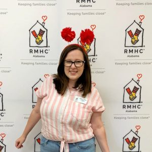 Zelma Mae in front of RMHCA-branded background at the RMHCA 40th Birthday Party