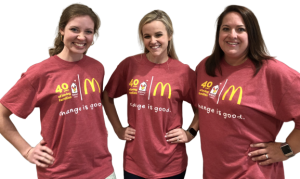 Three women wearing the Day of Change t-shirt.