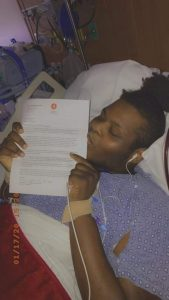 Za'Kelby kisses the letter confirming his place on the heart transplant list.