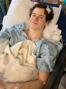 Teenager laying in hospital bed