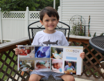 Young boy holds a photo album