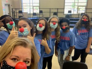 Students pose in red noses