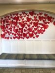 With Love wall decorated with paper hearts
